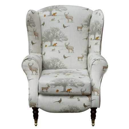 Duchess Wingback Armchair in a Tatton Autumn Print with front castor Legs