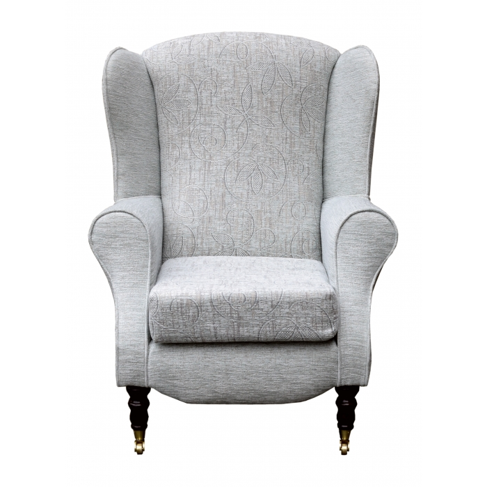 Duchess Wingback Armchair in a Bloomsbury Natural Floral and matching Plain fabric with front castor Legs